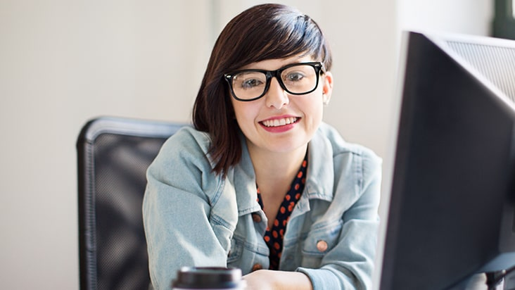 woman smiling with computer