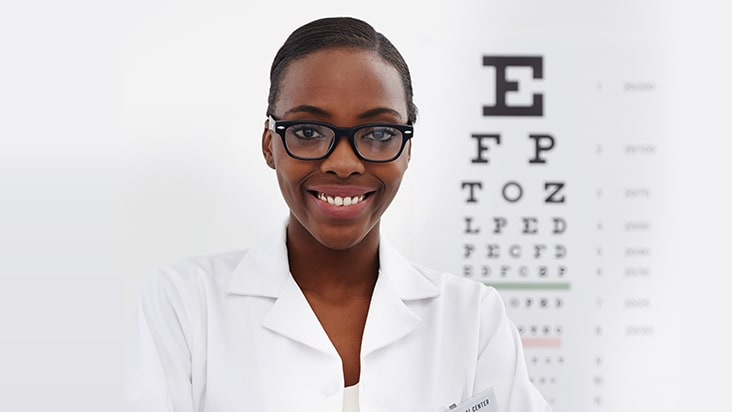 optician with letter chart