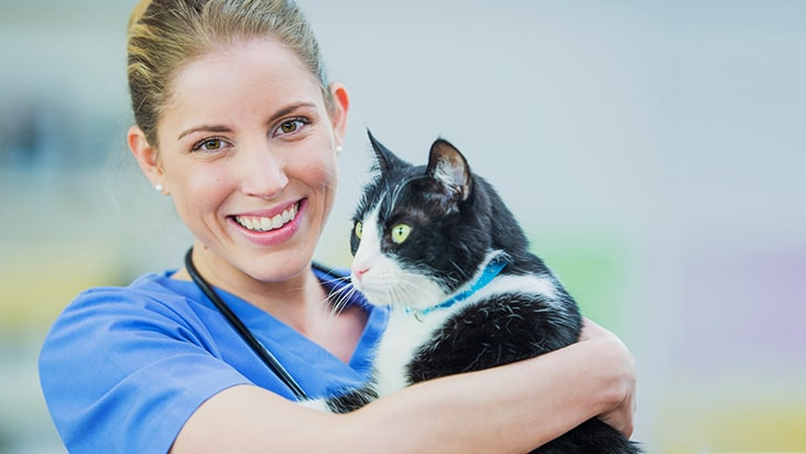 woman smiling with cat