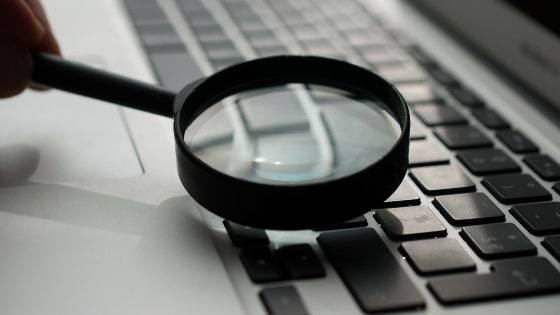 Magnifying Glass looking at keyboard