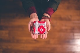 person holding small present
