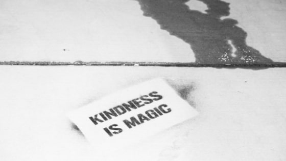 black and white photo of card that says kindness is magic