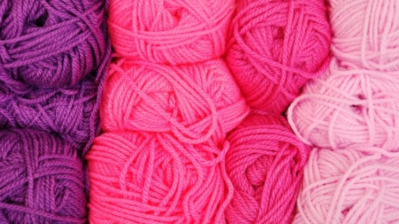 close up photo of different colored yarns