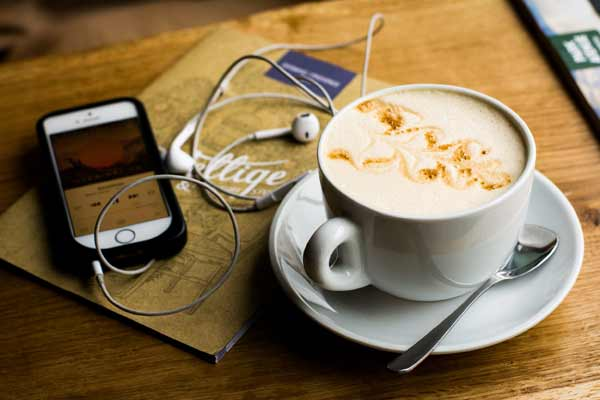 Iphone Headphones playing music & coffee