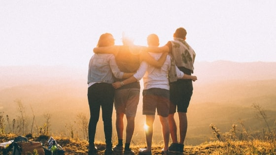 4 friends watching the sunset together