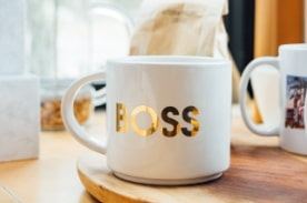"mug with gold letters saying ""boss"""