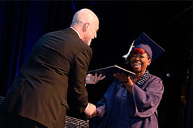Penn Foster student receiving diploma
